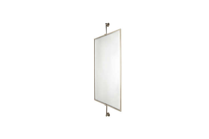 For an off-the-shelf version of the custom rectangular mirror in the bathroom, the WaterworksCrystal Wall-Mounted Rectangular Mirror on Bar is $