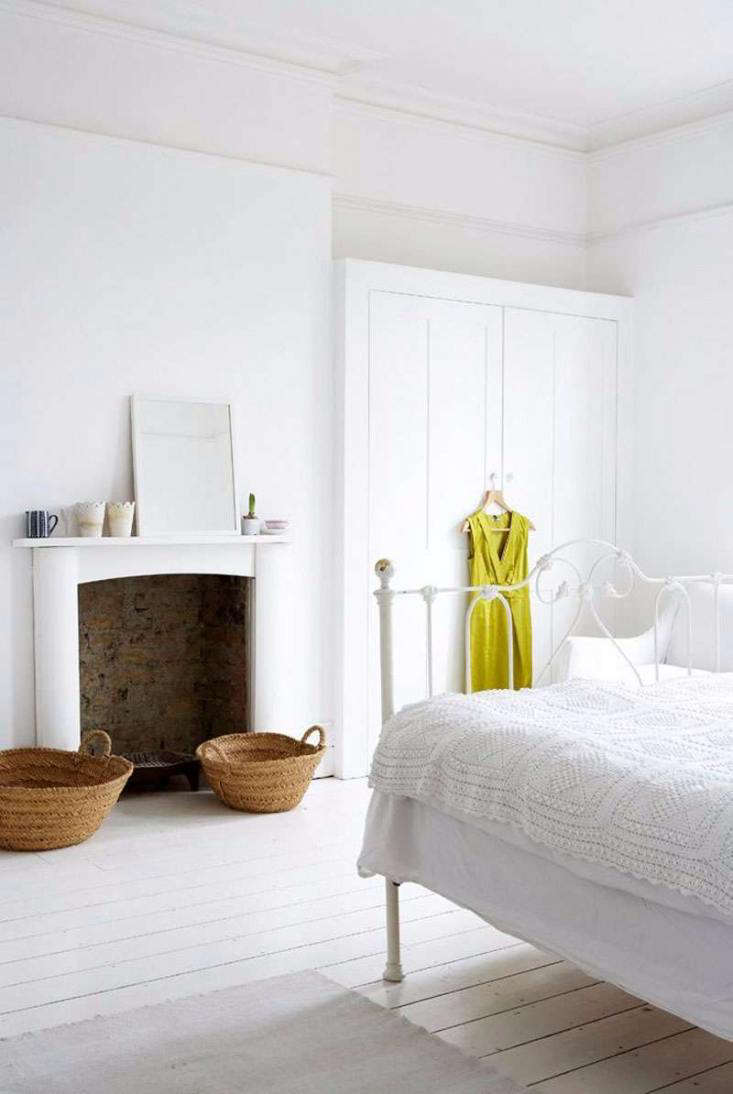 In her London Victorian house, British style authority Jane Cumberbatch poetically pairs bright white with market baskets and a favorite dress. Photograph by Rachel Whiting, courtesy of Jane Cumberbatch.