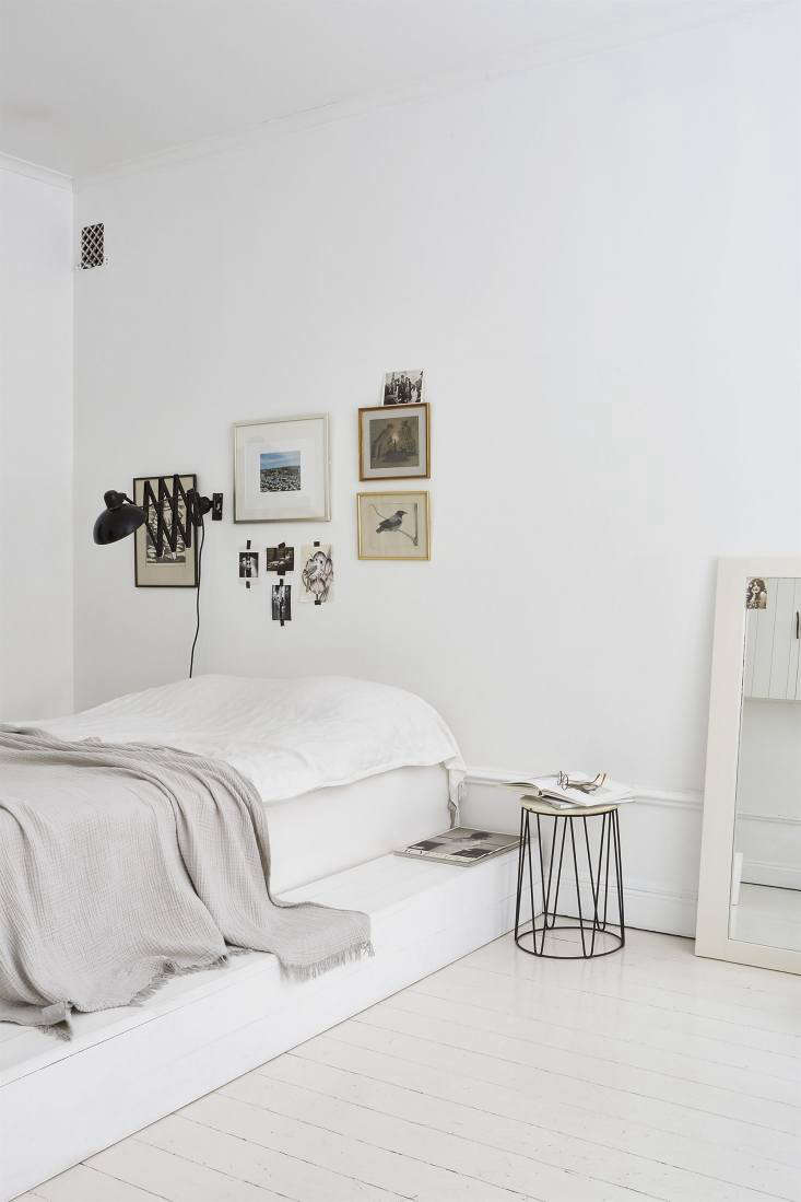 The White Album 27 Serene Bedrooms in Shades of Pale A white platform bed and inventive art arrangement at home in a Fantastic Frank apartment in Sweden styled by Josenfin Haag. Photograph by Emily Laye, courtesy of JH.