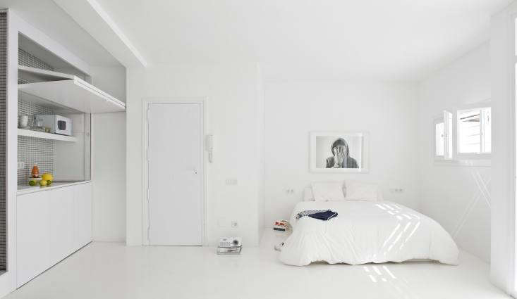 The White Retreat in Sitges, Spain, was designed for a French art historian who requested a clean slate, disappearing kitchen included.