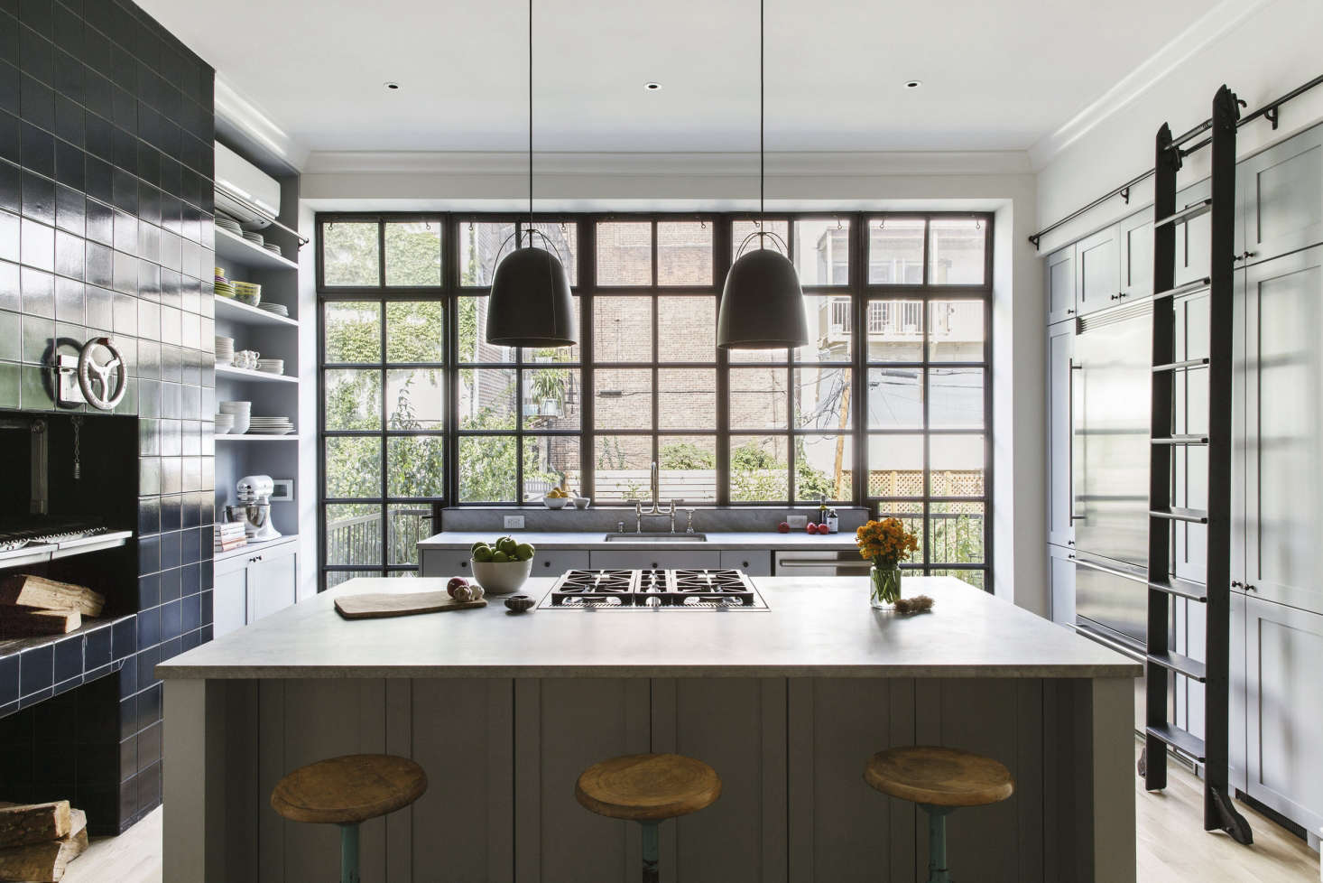 In a Brooklyn kitchen, Elizabeth Roberts added a wall of cabinetry accessed via a rolling ladder from Rolling Ladders. For more, go to Brooklyn Revival: A Bright and Open Family House. Photograph by Dustin Aksland, courtesy of Elizabeth Roberts.