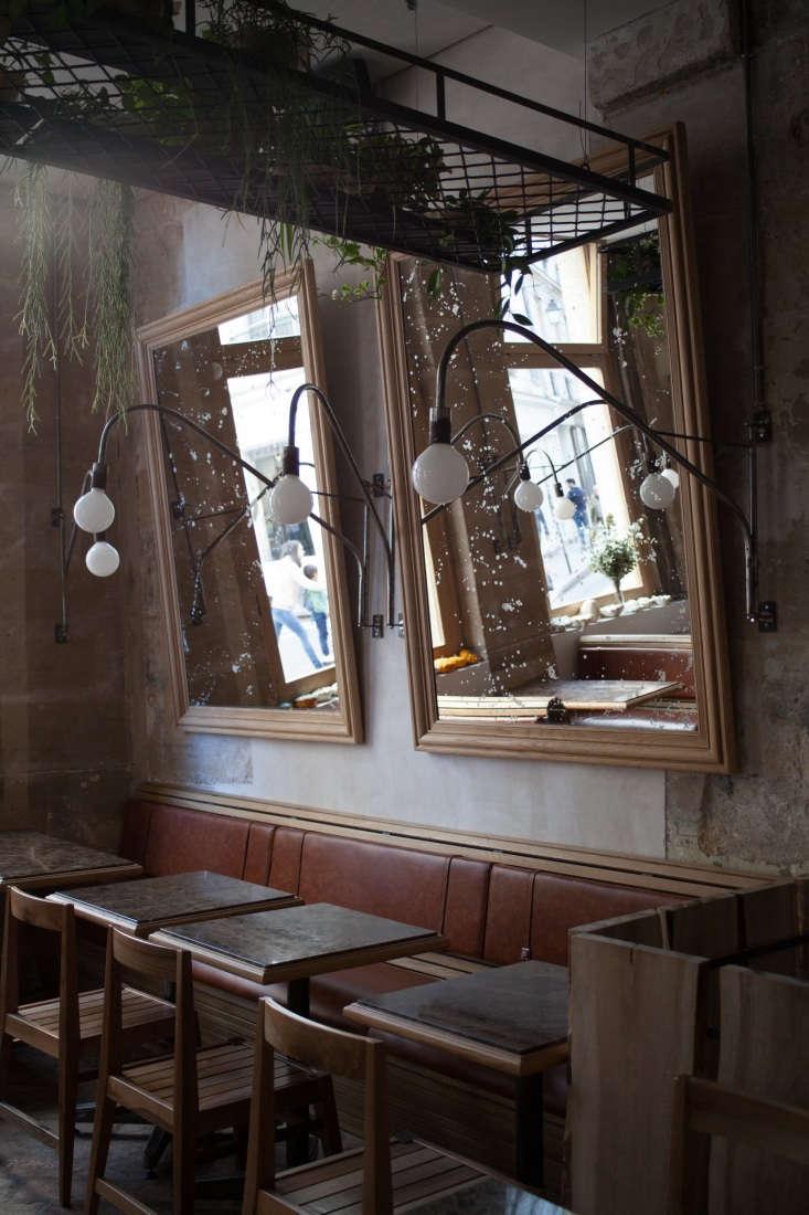 Custom houseplant shelves hang overhead throughout the restaurant.