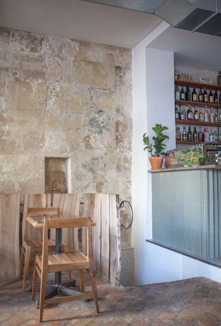 A bar with Mutina Rombini tilesstands in contrast to the original stone walls.