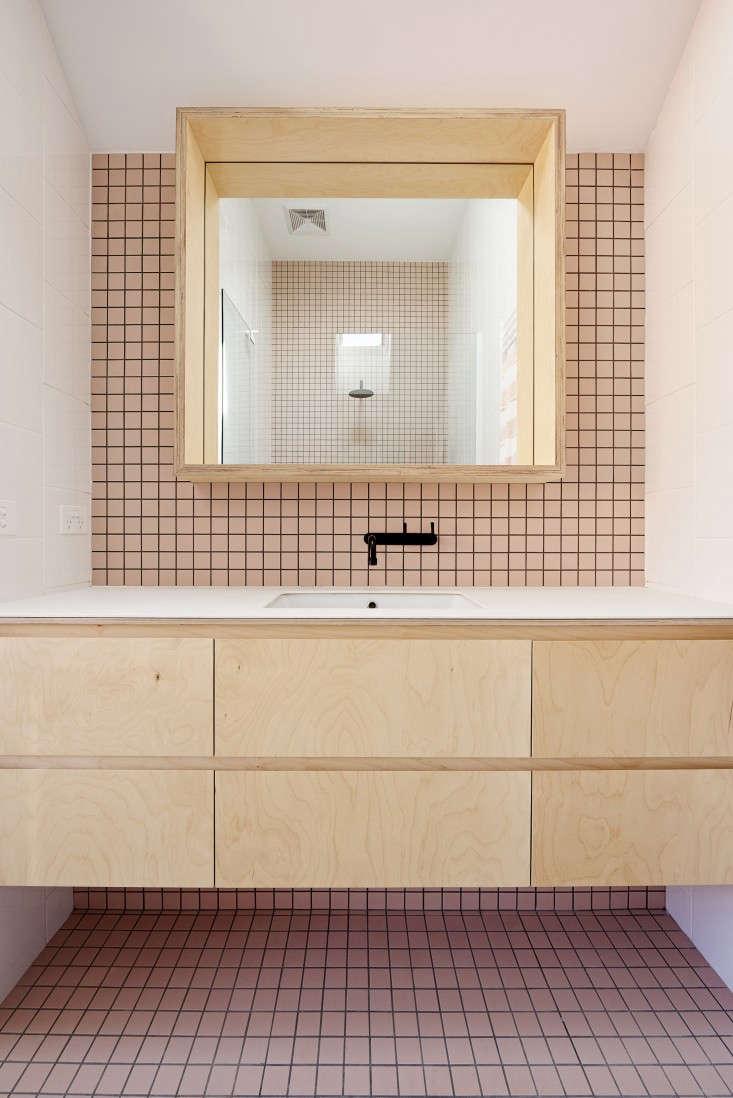 australian designer dan gayferoutfitted a family bath in pale pink tiles, lig 9