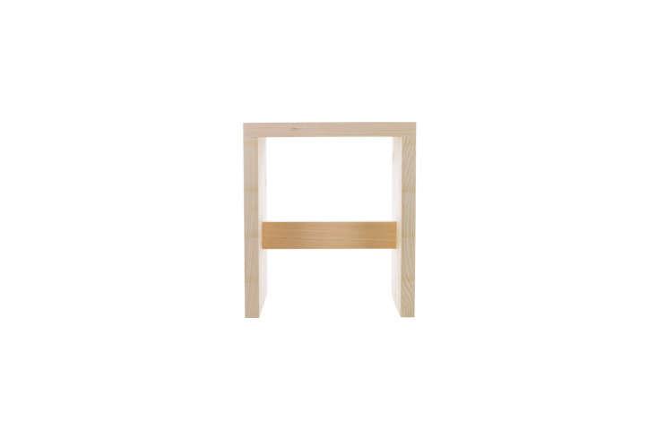 a straightforwardhinoki wood stool by designer yoko ueno lewis has a grooved  11