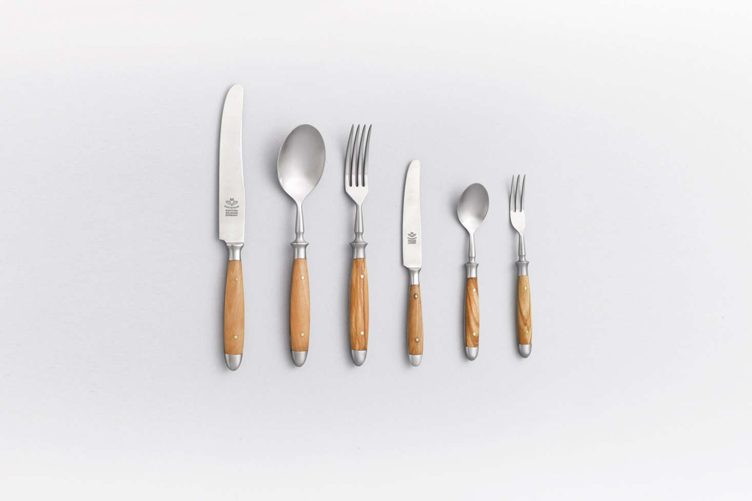 Eichenlaub Flatware, forged in Solingen, Germany, are each made from a single piece of stainless steel and finished with wood, horn, or acrylic handles. The set shown here, in light oak, is available in Japan at Arts & Science and online at Scharfer Laden in Germany; €53. per piece.