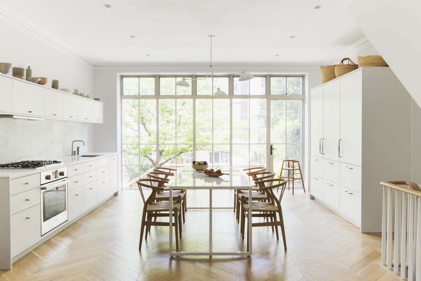 In a Brooklyn kitchen, Elizabeth Roberts designed a capacious, freestanding cabinet to accommodate the fridge; see more at A Warm, Minimalist Duplex in Brooklyn by Architect Elizabeth Roberts. Photograph by Dustin Aksland, courtesy of Elizabeth Roberts.