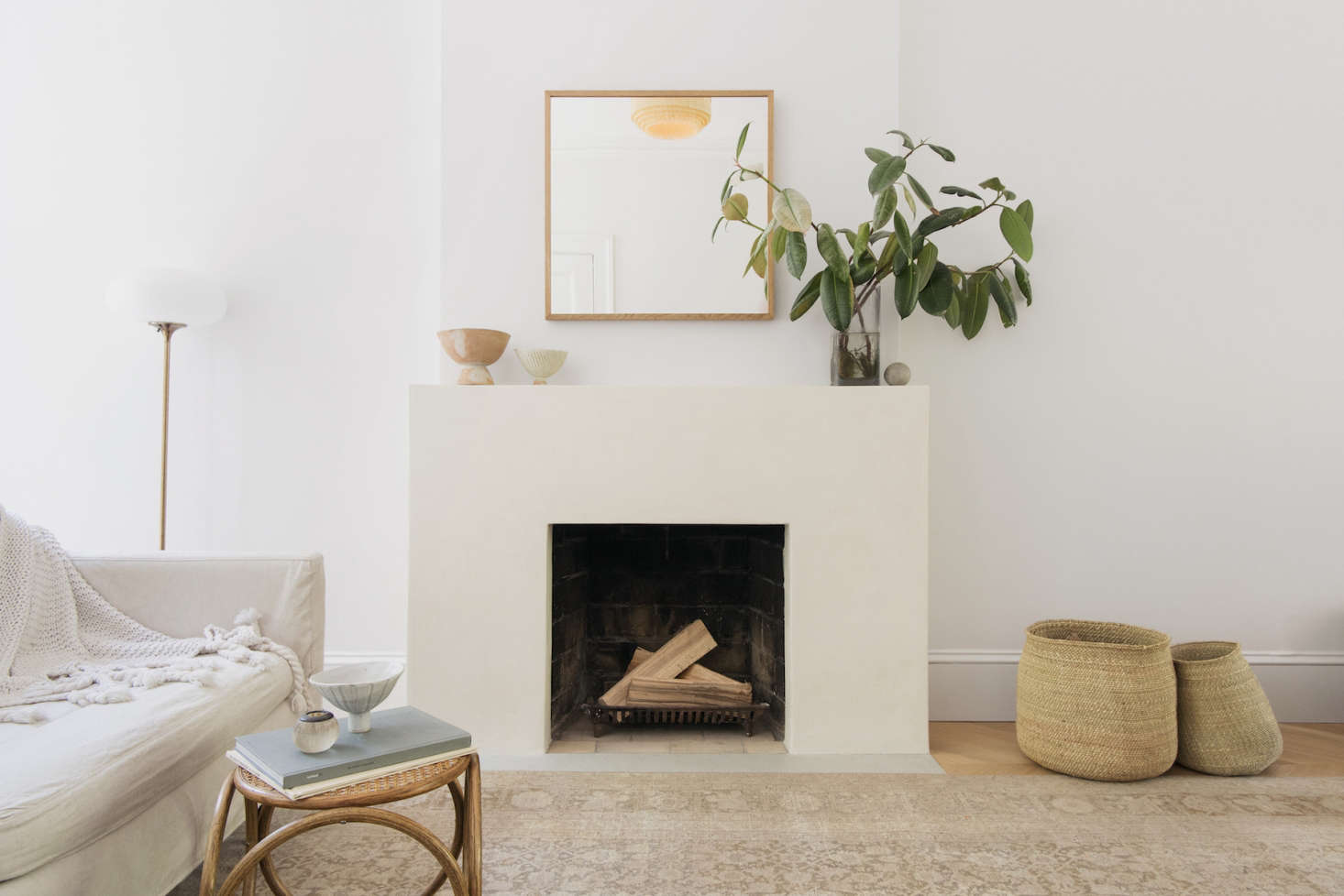Architect Elizabeth Roberts opted to coat the living room fireplace surround in tadelakt for added texture. Photograph by Dustin Aksland, courtesy of Elizabeth Roberts, from A Warm, Minimalist Duplex in Brooklyn by Architect Elizabeth Roberts.