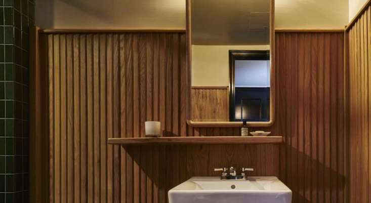 The guest baths are clad in wood paneling.
