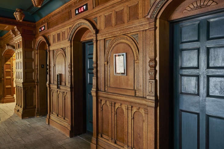 Inside, the original millwork was restored in the lobby's elevator bank. The elevator doors are painted in Benjamin Moore&#8