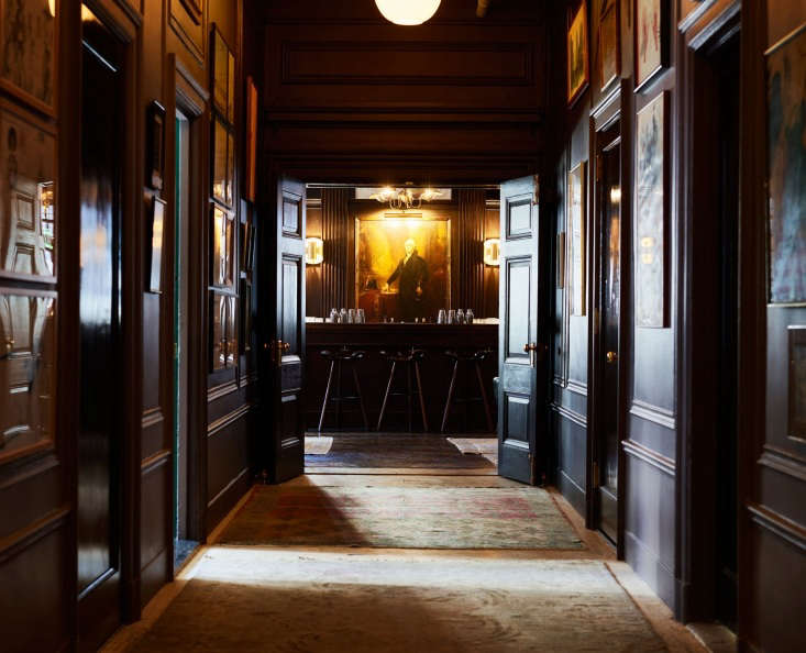 The portrait of George Washington was already hanging in the building; Roman and Williams decided to have it professionally refurbished and rehung, hence the name of the dimly-lit George Washington Bar.