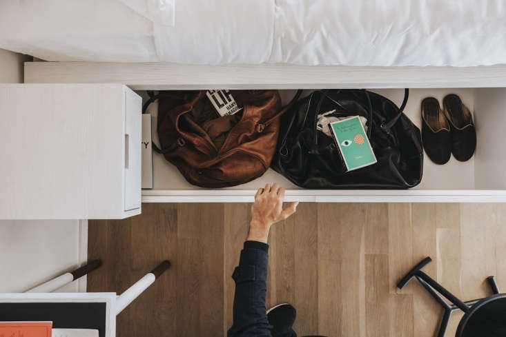 Rooms have custom-designed storage furniture like beds with drawers beneath.