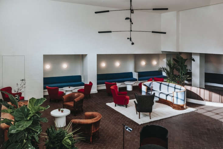 The large lobby has potted plants and velvet furniture in faded colors—throwbacks to hotels of an earlier era.