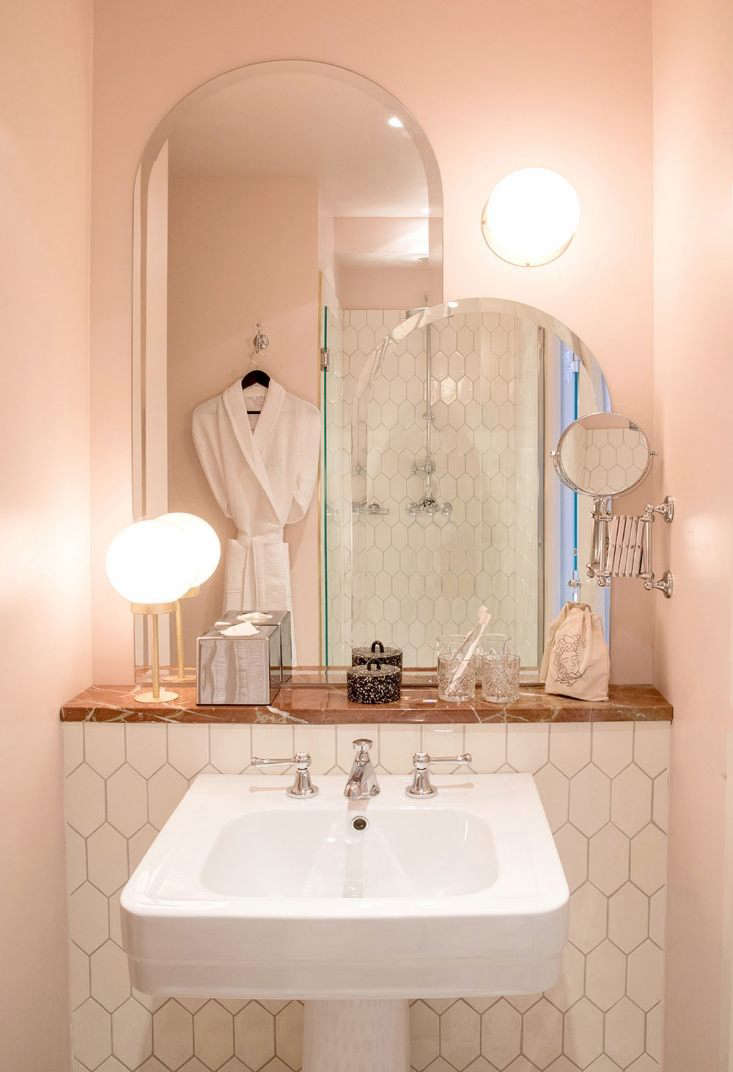 cotton candy colored walls are matched with deep pink marble in a guest bath at 18