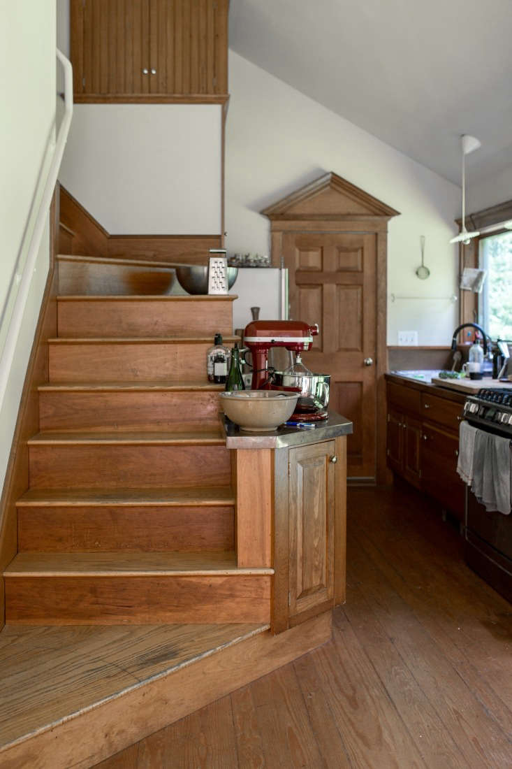 the kitchen is tucked beside the staircase; the couple made only a few small  16
