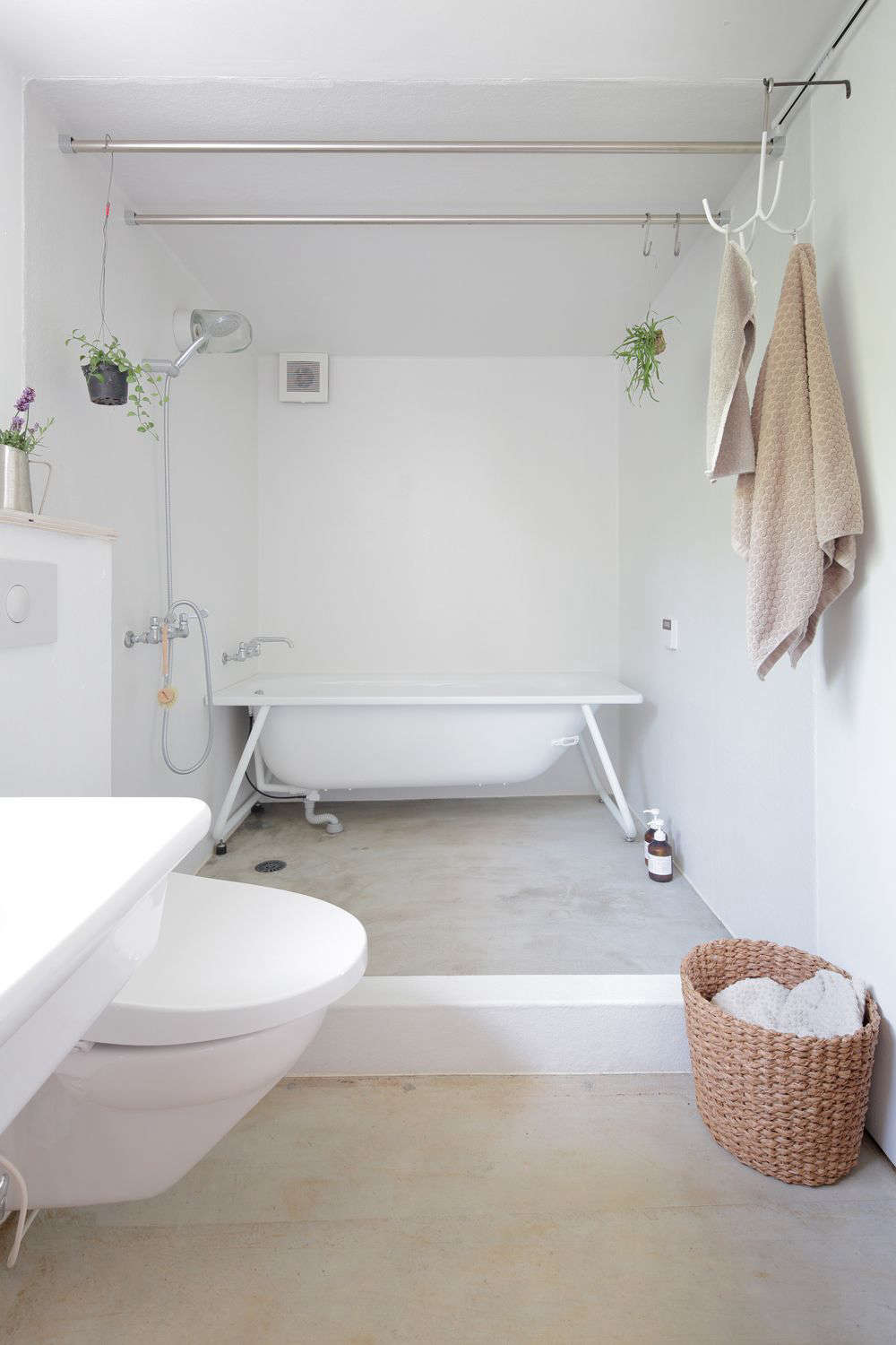 The rakish tub is a Kaldewei TForm Bathtub, a model made to be inset but here used with an exposed frame.