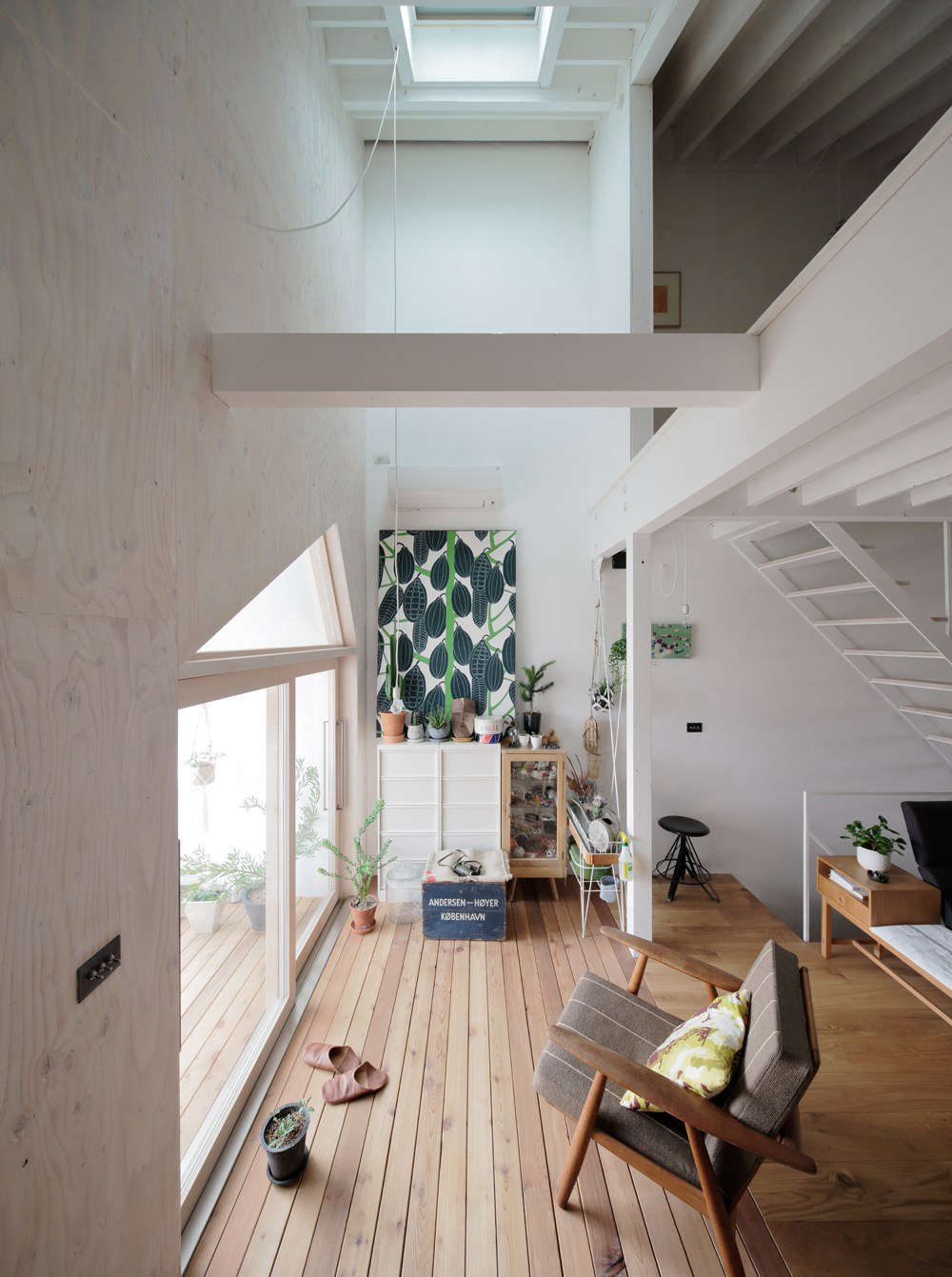 The living area is oriented to the front, south-facing balcony and brightened by a skylight. That&#8