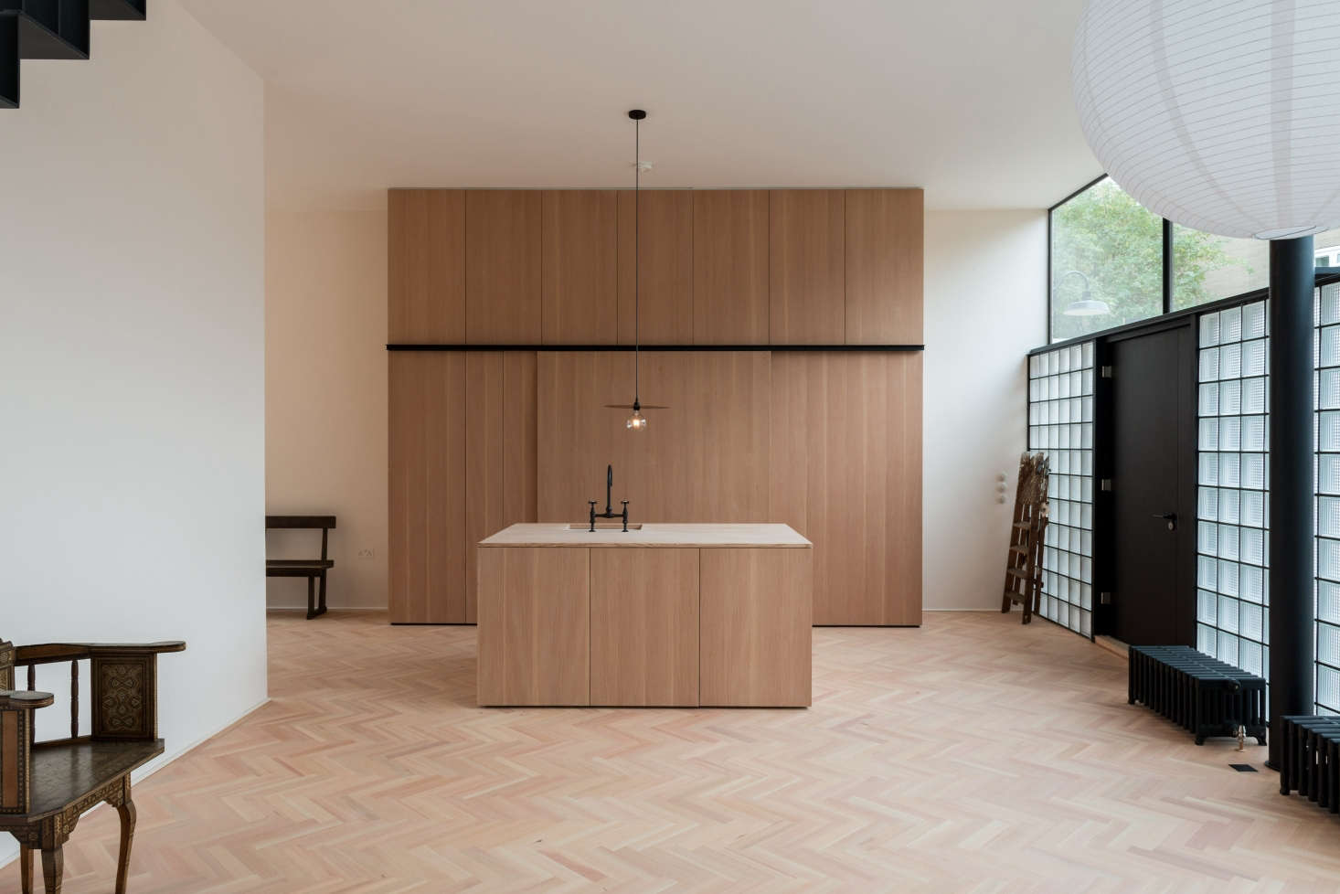 In a project by Frame, a design-led property firm founded by architects Nick Mansour and Hugo Braddick, all kitchen storage is concealed in built-in floor-to-ceiling cabinetry. See more at A London New-Build Inspired by the Iconic Maison de Verre.