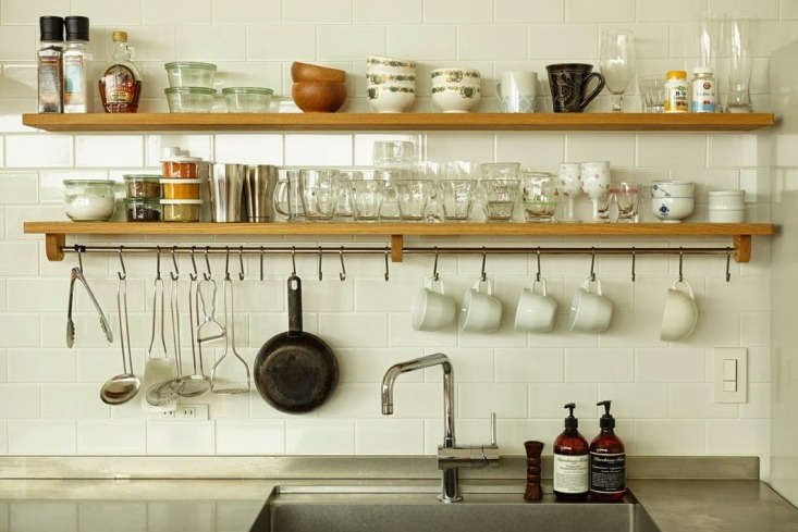 Kitchen of the Week A Finely Tuned Kitchen in Kobe by a Thoughtful Japanese Workshop Shelves and a built in tool rail hang above the stainless steel sink. S hooks corral tools and mugs.