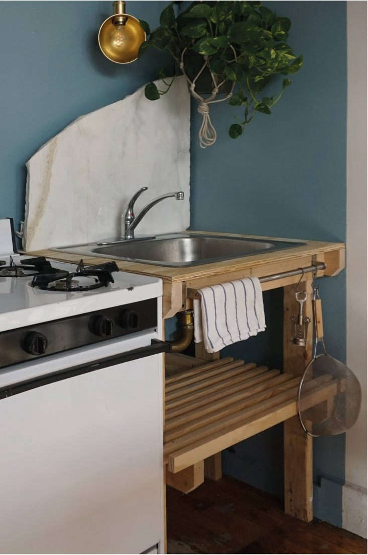 The simple stainless steel sink was salvaged from the original kitchen and placed in a new wooden frame that was designed and built by Bak, inspired by Danish farmhouses &#8