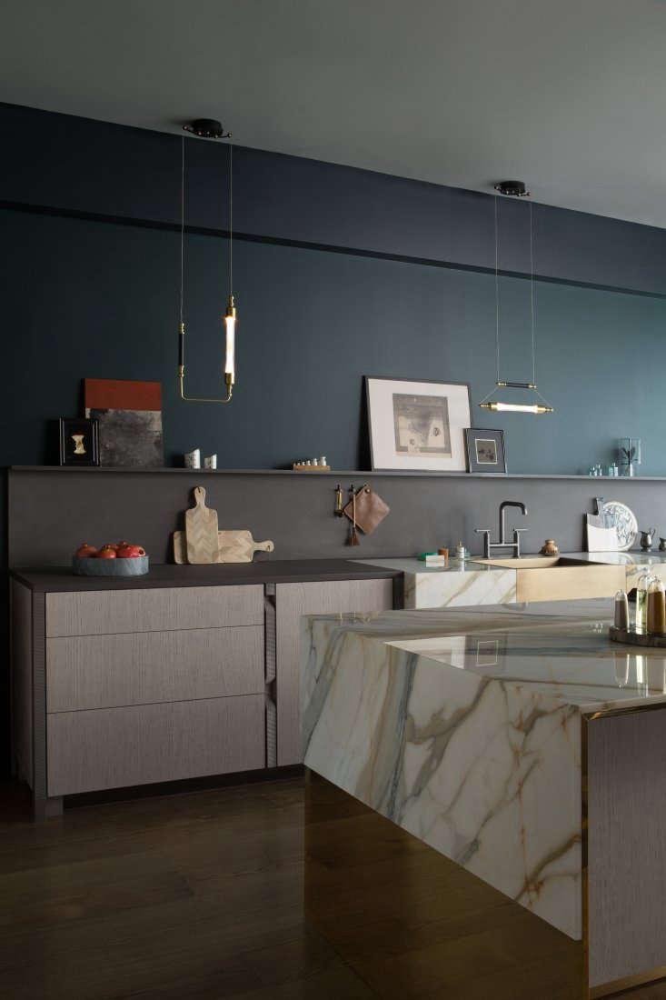 black walnut cabinets flank a butler&#8\2\17;s sink of brushed brass framed 10