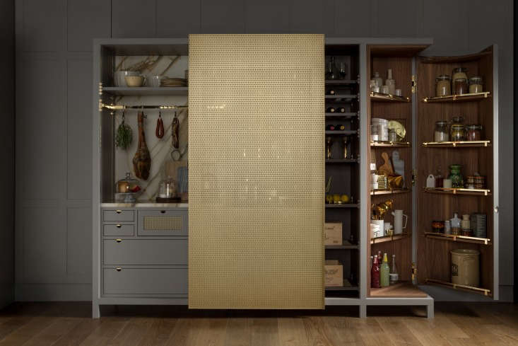 at the far end, a walnut lined corner cabinet makes the most of a compact space 22