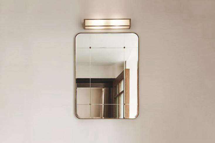 The Lind & Almond A Bathroom Mirror for Sanders is framed in hand-patinated brass. Contact Lind & Almond for ordering information.
