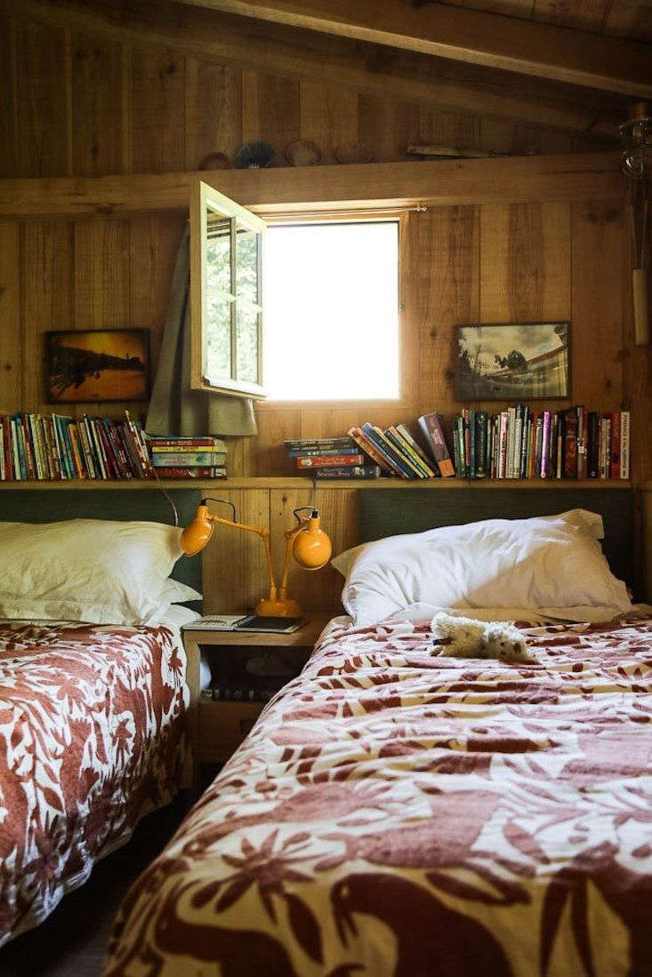 a wood lined bedroom evokes cabins, cottages, and camp—pure summer. photograp 14