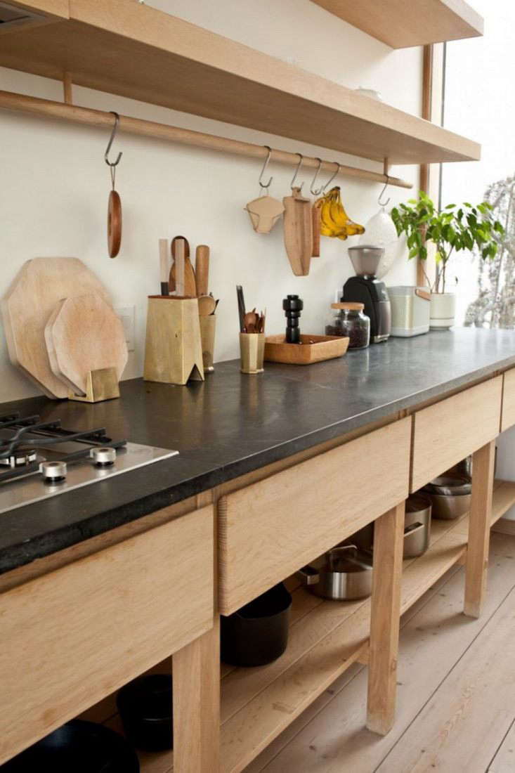 a custom oak cabinet with soapstone counters and open and closed storage anchor 10