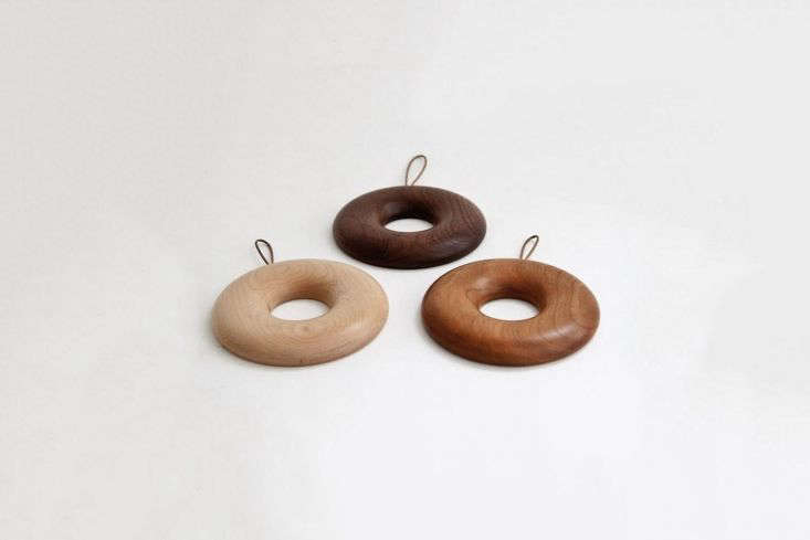 designed by hidetoshi takahashi, thebagel trivet is made of japanese maple (a 22