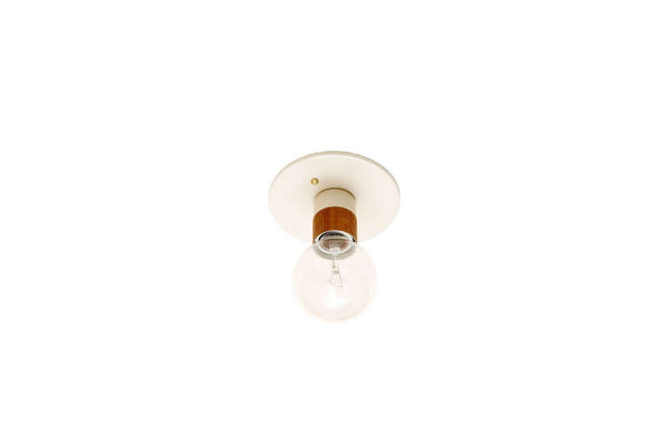 10 Easy Pieces Modern White Ceiling Socket Fixtures from 5 to 300 TheFremont Light in white and wood veneer is \$85 from Onefortythree.