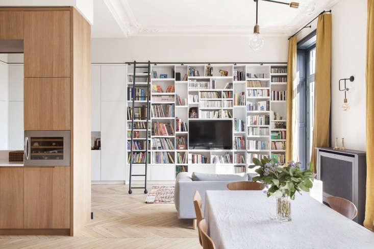 paris apartment open floor plan parquet floors white bookcase 1