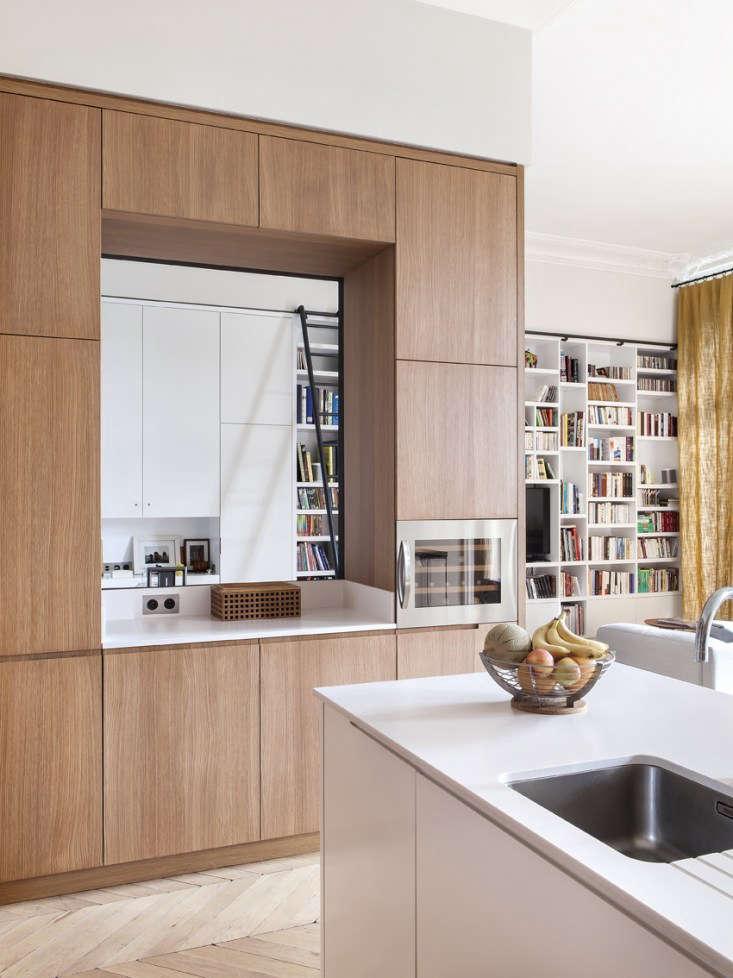 paris apartment open floor plan parquet floors white bookcase 3