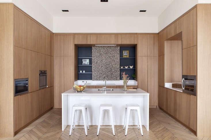 paris apartment wood kitchen parquet floor white island 1