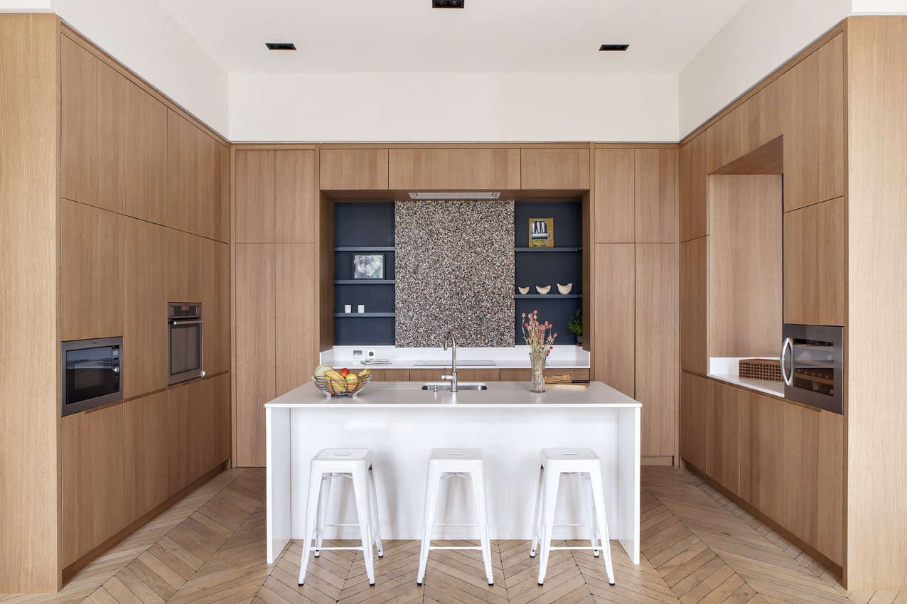 In a grand Parisian apartment, Camille Hermand Architectures modernized the kitchen with floor-to-ceiling built-in cabinetry. For more, see In Paris, a Grand Apartment Gets an Update for a Modern Family. Photography by Hervé Goluza, courtesy of Camille Hermand Architectures.