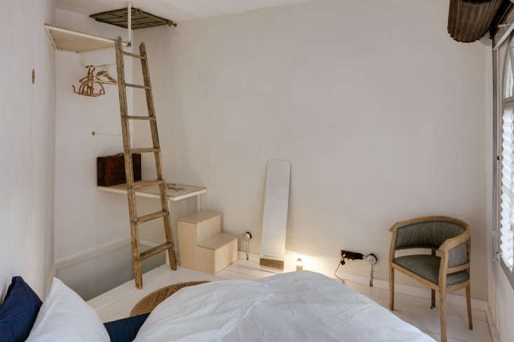 Passer Domesticus 12 Ideas to Steal from an Idiosyncratic Urban Getaway in Greece Yet another tiny built in level: A small plywood step leads to a rudimentary closet with two exposed pipes and hangers. A mirror becomes an architectural element when leaned against the wall.
