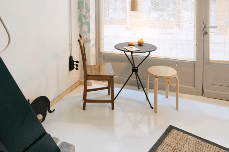 Passer Domesticus 12 Ideas to Steal from an Idiosyncratic Urban Getaway in Greece Small scale furniture keeps the space feeling open, as shown here, in the mix and match dining area. A petite rug emphasizes the empty floor space and keeps the room feeling sparse.