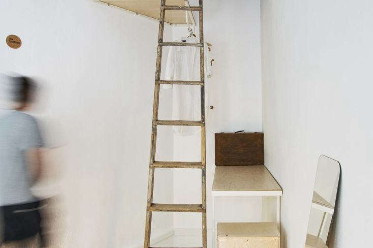 Passer Domesticus 12 Ideas to Steal from an Idiosyncratic Urban Getaway in Greece The designers used vintage ladders throughout as a space saving measure. Here, awell worn ladder, found on site, leads to the building&#8\2\17;s flat roof and doubles as a place to drape clothing.