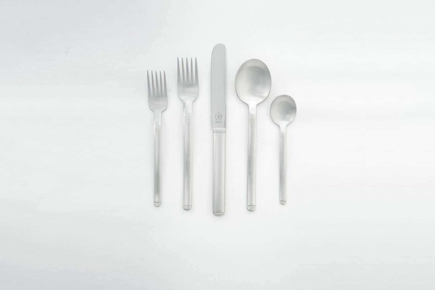 The Carl Pott Pott 33 Flatware from 75 is weighty, has a horizontal etch at the base, and a five-tined fork. Made in Mettmann, Germany, the five-piece set is $380 at Horne. Photograph by Heidi Swanson, who formerly carried the set at her shop Quitokeeto.