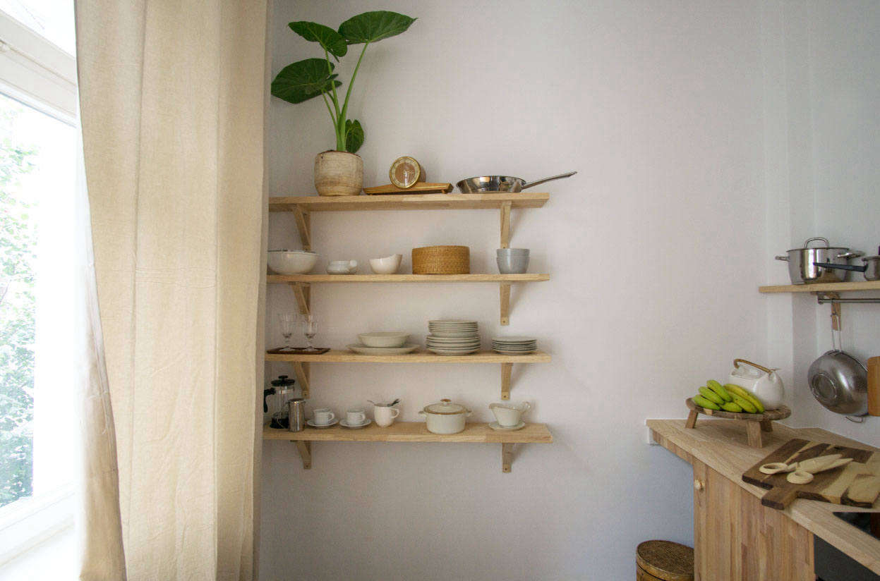The simple wall shelves in the kitchen are Ikea Ekby Valter Brackets and Ekby Hemnes Shelves in birch.