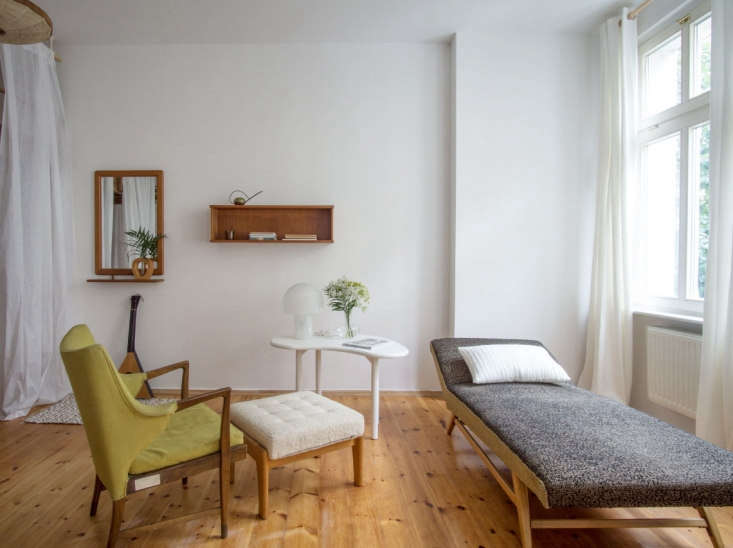 the designers separated the studio apartment into two spaces; the loft bed is c 9