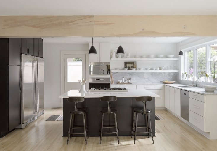 Izabella and Brandon worked with a local kitchen design store on the black and white cabinets; the design was their own. The red oak hardwood floors were bleached three times to achieve the look (for more see Scandi Whitewashed Floors: Before and After). Photograph by Matthew Williams from Before & After: Remodelista Contributing Editor Izabella Simmons Shares Her Scandi-Inspired Remodel.