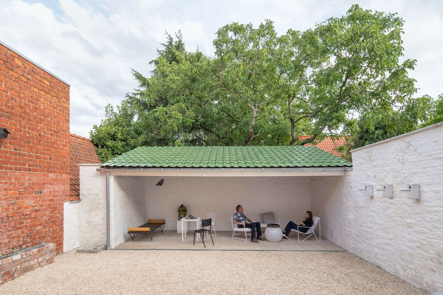 The owners of the Good Repose house relax in the semi-covered courtyard. (For more on the courtyard design see our post on Gardenista.)