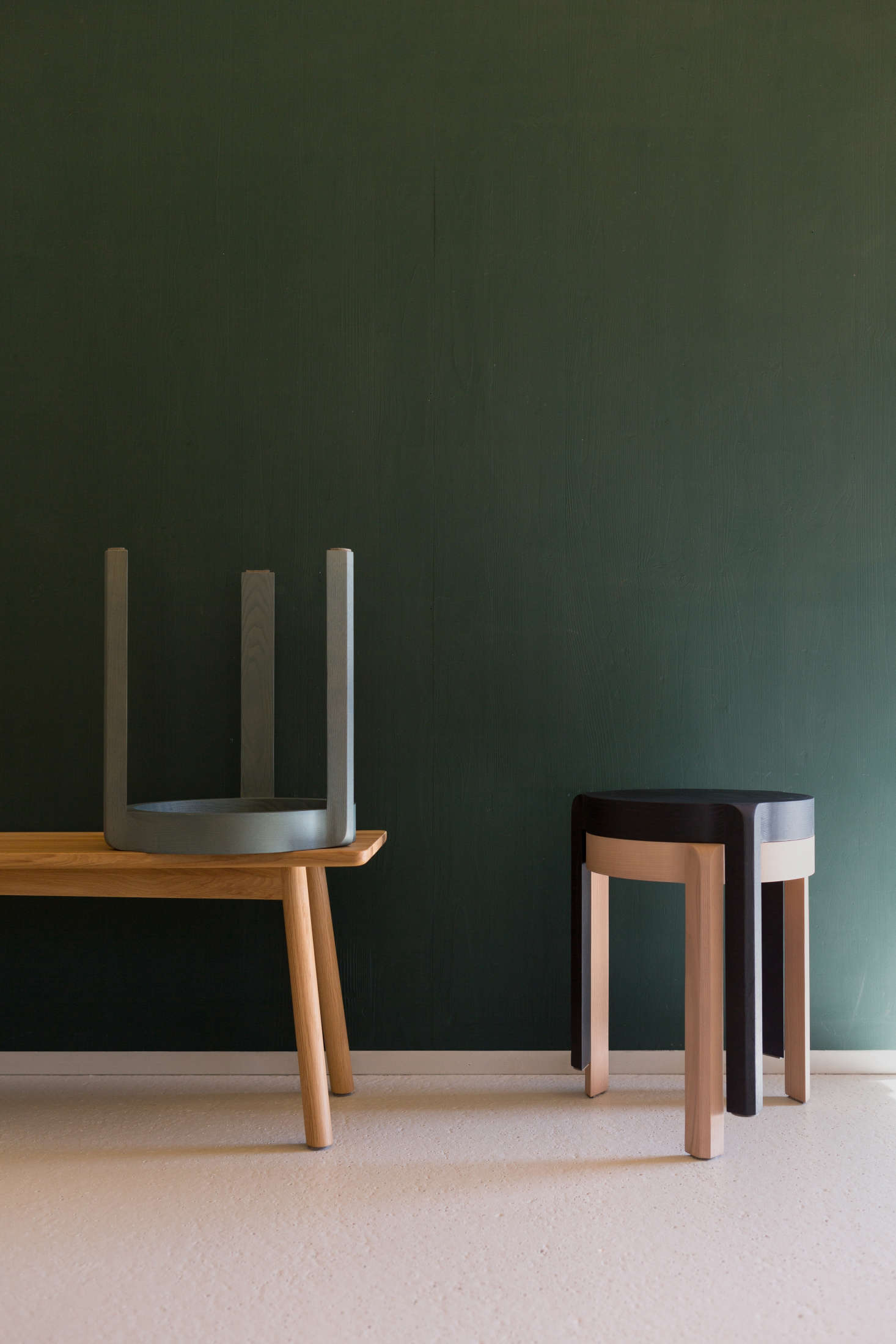 The stools have steam-bent legs and are designed to stack.