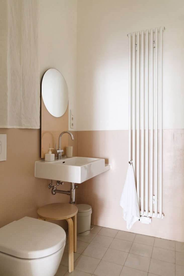 in a berlin apartment, designers studio oink painted the lower half of the bath 13
