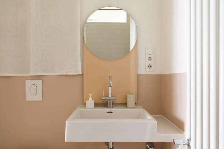 a geometric peach toned mirror completes the palette. 14