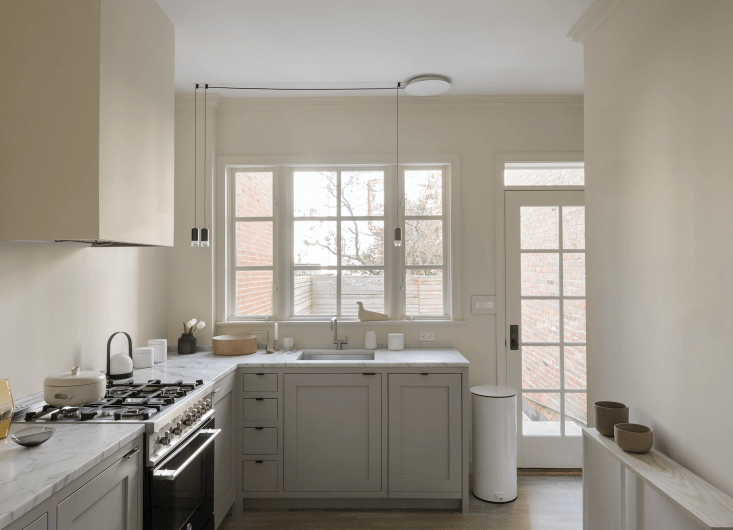 """The kitchen renovation was partially complete when Studio Oink joined on. The owner had worked with Four Brothers to realize a cabinetry concept inspired by Plain English (""""square inset flush, graduated drawer size"""") and painted it inBenjamin Moore&#8"""