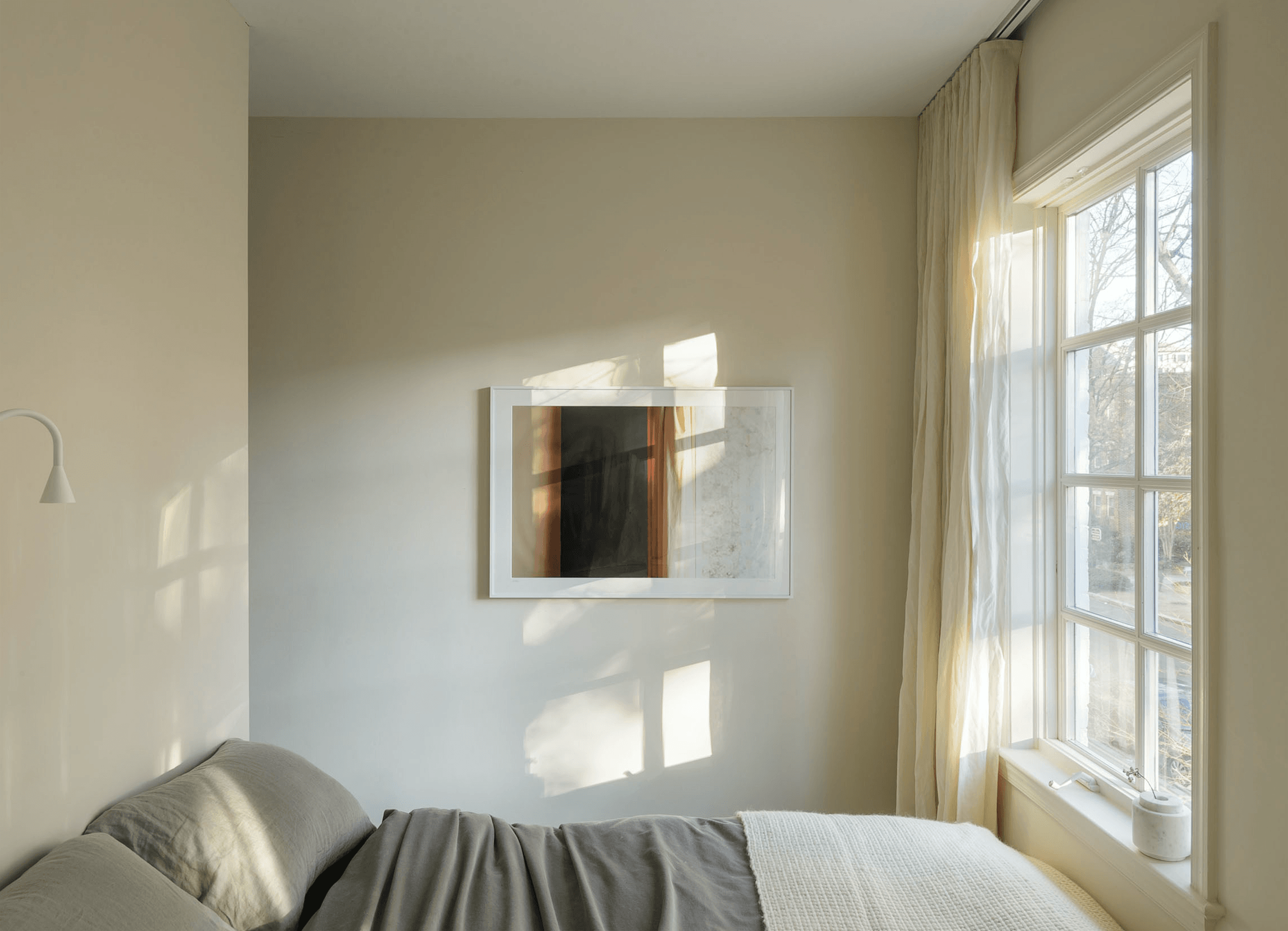 The pocket-size bedroom is painted in Farrow & Ball&#8
