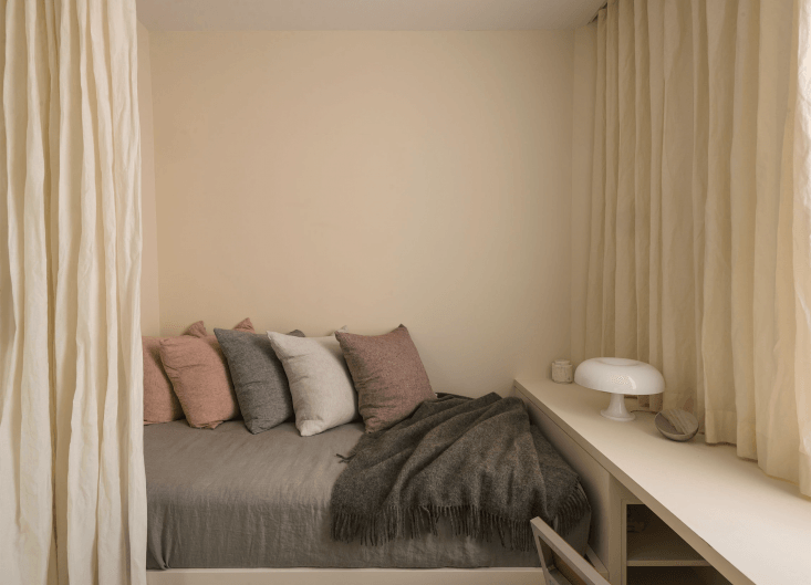 Seen here in a Studio Oink-designed guest bedroom in Washington DC, the Thompson Trundle Bed, can be pained to match any interior (like it is here, painted in Farrow & Ball Slipper Satin).