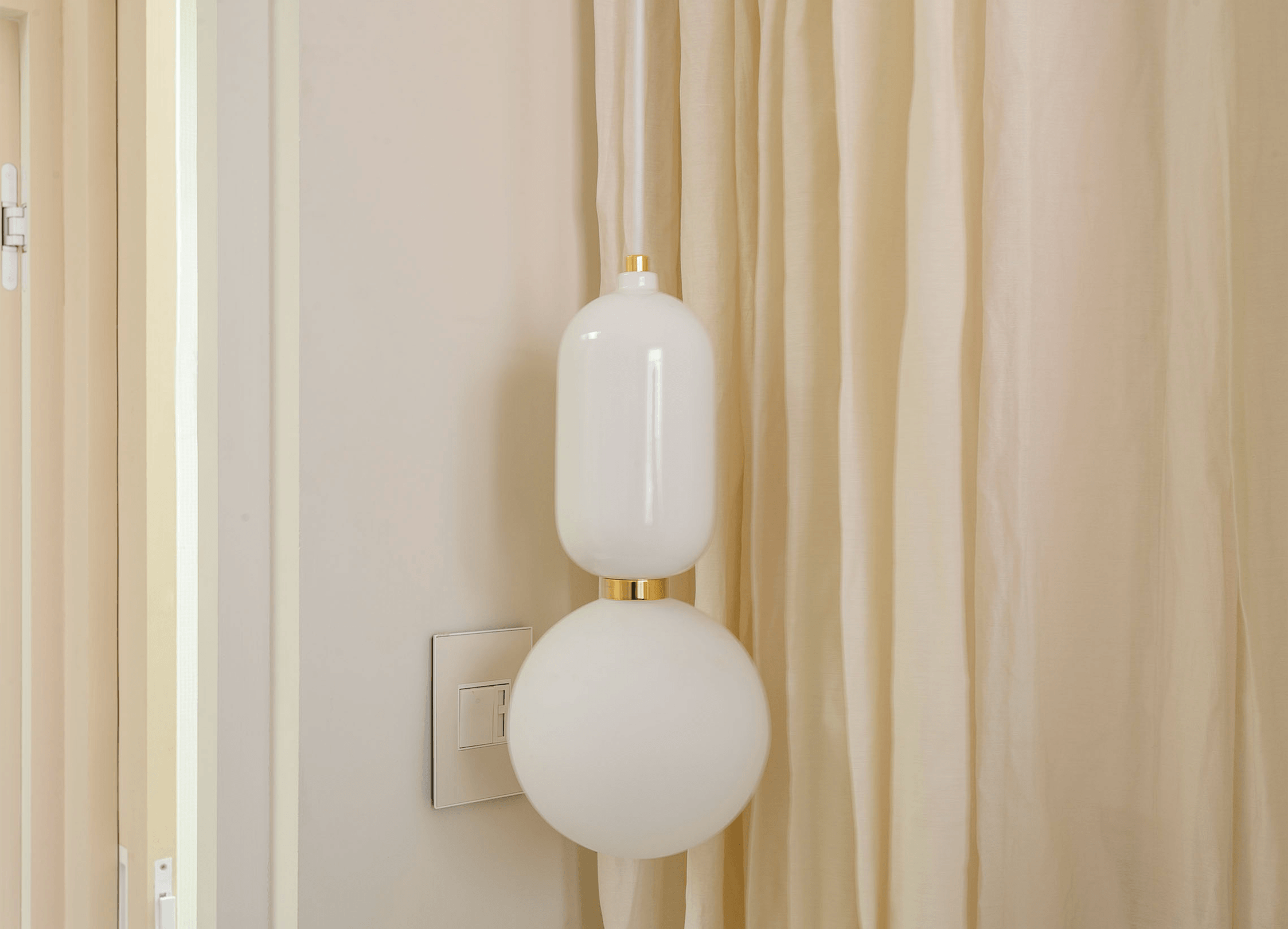 Custom-painted European-style switches and an opaque globe pendant are among the owner&#8